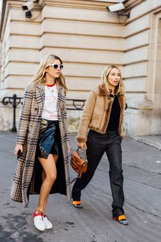 Paris Fashion Week Street Style: Patent mini skirt, coats, sneakers and white sunglasses