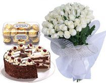 A Hamper Of 24 White roses bunch 16 Ferrero rocher chocolates 1/2 Kg cake.