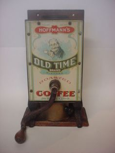 ANTIQUE COFFEE GRINDER HOFFMANNS OLD TIME BRAND TIN LITHO EXCEPTIONAL CONDITION. Sold on ebay for $985.00