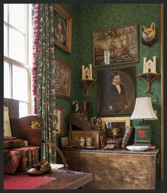 British vignette While I could do without the angry-looking little fox's head, this is about as close to perfection as I can imagine. Tartan book covers, the color of the wallpaper, THOSE CURTAINS!, the tin lamp base, beautiful table and desk, etc., etc., etc.