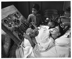 happy birthday to Frida Kahlo born 6 July 1907. Here she is painting from her bed.