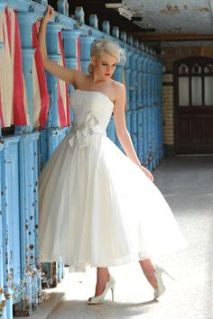 A really chic and stylish wedding gown from Ivory & Co. The skirt in the full silk organza is simply gorgeous and the 1950′s styling gives it a pretty, retro vintage feel. One of our most popular designs. This dress is also available as full length as well as tea length.   www.blissfulgifts.co.uk | enquiries@blissfulgifts.co.uk | tel 07549 872008
