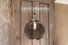 Pendant Lighting with 10 Inch Smoke Glass Globe by lucentlampworks