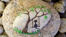 Hand painted stone, Lonely cat, via Etsy.