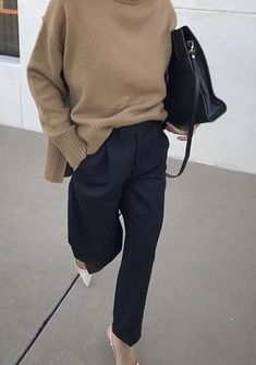 Camel sweater draped with slick black pants