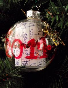 Preserve your child's Christmas list in an ornament every year. I had saved my son's, so I made 2 just before Christmas. I also added a tiny Christmas charm, and a sprig of garland inside to make it a little more festive.