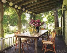 Why not turn your front porch into your dining room? A rustic farm table, bistro chairs and some paper lanterns make this spot a perfect one for entertaining. Not surprising, considering it belongs to NYC restauranteur Keigh McNally. See more of this outdoorsy Martha's Vineyard home on Elle Decor.