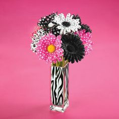 Zebra Vase Trend Stem Arrangement---Love this vase and I'd fill it with real gerbera daisies in hot pink and white.