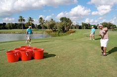 Golf Pong: like the drinking game beer pong, and players chipped golf balls into six large red barrels.