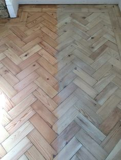 Specialist installing new and reclaimed parquet floors.