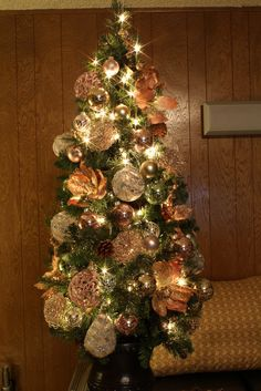 4 Foot Victorian Themed Christmas Tree - using gold glittered peach poinsettias and magnolias to put the florals at the center of this theme.