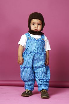 These unisex dungarees for children aged newborn to 4 years old are handmade and created in an incredible 100% waxed african print cotton fabric  Double buttoned on the strap for extra length, the unisex dungarees also feature two side buttons to make changing nappies easier.   http://www.whatmothermade.co.uk/girls-clothes-what-mother-made/unisex-dungaree-in-waxed-african-print
