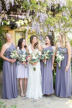 Bride Keri in Ojai, CA chose Donna Morgan 'Rachel' in Grey Ridge for her bridesmaids. Discover more designer bridesmaid dresses to rent at vowtobechic.com.