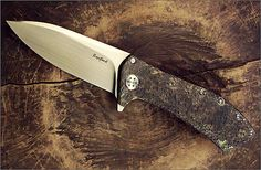 """Todd Rexford – Epicenter XL Flipper  Type of lock: Frame lock  Blade Length: 4 1/4""""  Overall Length: 9 11/16""""  Blade Material: CPM S35VN with satin hand rubbed finish  Frame Material: 6AL4V Titanium hot hammered textured and anodized  Pocket clip: 6AL4V Titanium textured and anodized to match frame Tip Up carry  Backspacer: Spun titanium standoffs  Blade pivot: Custom stainless steel pivot bolt riding on phosphor bronze washers"""