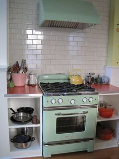 LOVE these kitchens! I must have a retro stove and fridge someday!!