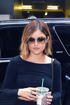 To co-opt Lucy Hale's tousled bob, start with dirty hair, spritz on ginger-scented Arrojo dry shampoo and then randomly curl and bend sections of hair vertically around a 1-inch barrel iron. Crucial: leave the ends out for that piece-y look.