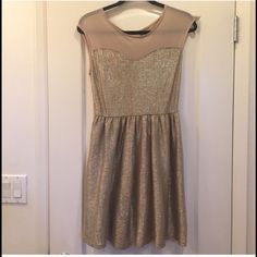 Gold Party Dress Nude mesh top, gold bodice and bottom. Never worn. one clothing Dresses
