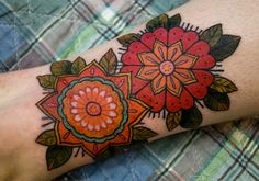 I love these, the colors are awesome. They're like the girly version of borneo roses (tribal rose tattoos thought to protect one from evil).