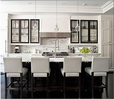 Sleek black and white and Carrara marble everywhere. - Love how the wall cabinet door frames match the island.