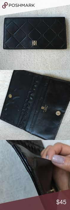 Givenchy Vintage Leather Slim Wallet Classic Givenchy slim leather wallet. In very good shape except for some loose stitching on one side. Inside has three pockets. Backside has one pocket and one zippered pocket. Leather and made in France. Givenchy Bags Wallets