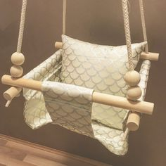 • Relaxation Swing • My handmade swing is designed for gentle, relaxing swinging for your little one. Suits babies from 6 months old (sitting up) to 2 years. Matching cushion included. Material is 100% cotton and wood is quality pine. Choice of 100% cotton or white weatherproof rope. Swing includes cushion, rope, ring, carabiner and sensory beads. Please allow 1-2 weeks for swing production and 5-6 days for postage. Adult supervision is required whenever child is in the swing. Rock Ya T...