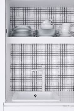 The White Retreat, Sitges, Spain. Small all white apartment design by CaSA. Photo by Roberto Ruiz Bright Apartment, White Apartment, Small Apartment Design, Small White Kitchens, Cool Kitchens, Kitchen White, Kitchen Small, Black Kitchens, White Mosaic Tiles
