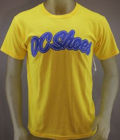 DC Shoes yellow shirt with raised blue logo