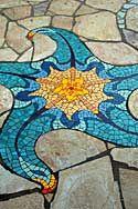 Stone & Tile Mosaic floor created by designer Lance Jordan.  (http://www.lancejordancreations.com/stone.htm)