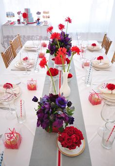 Grey and white tablescape with pops of floral red and violet. Happy!