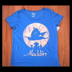 Disney Aladdin tshirt Brand new Disney aladdin t shirt. Design is a shiny gold. Tag is ripped but still attached to shirt. NO TRADES. Please use the make an offer function as I do not negotiate in the comments. Thanks! Tops Tees - Short Sleeve