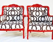 Antique redesign armchairs, painted in red color upholstered by best quality cotton geometric fabrics.