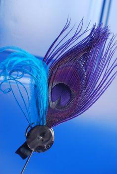 Purple peacock feather fascinator