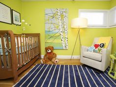 Fun, contemporary artwork fills the colorful nursery. The tree artwork is by Marimekko, while images of the Korean alphabet, a nod to the adopted boy's heritage, are hung above the crib.