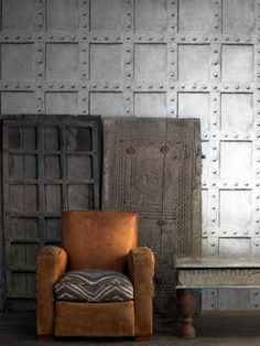 This wallpaper gives the look of a riveted metal sheet wall. Part of the Engineer Collection and very true to life. http://www.wowwallpaperhanging.com.au/andrew-martin-wallpaper-realistic-images-of-timber-steel-and-other-great-stuff/