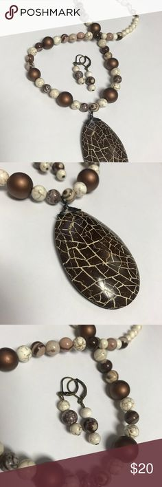 """Brown and cream stone necklace/ earring set Beautiful brown and cream necklace adorned with a 2.5 inch charm Matching earrings included in this set  Natural stone beads Approximately 18"""" length  NWOT Jewelry Necklaces"""