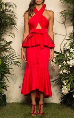 This **Johanna Ortiz** dress features a sheath silhouette with a criss cross halter neckline.