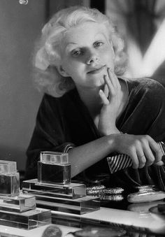 Jean Harlow, no make up...so young. Wonder what the perfume on the table was?