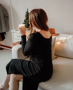 Photo shared by Encircled | Slow fashion on December 22, 2020 tagging @emmairenecavanagh. Image may contain: one or more people, living room, drink and indoor.