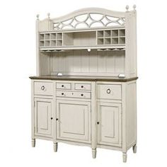 "Offering classic style and ample storage, this timeless 4-drawer buffet features 3 doors, ample bottle storage, and adjustable shelves.   Product: BuffetConstruction Material: WoodColor: CottonFeatures: Four drawers Three doors Bottle storage Adjustable shelves Silverware tray  Wine glass storage  Holds up to 16 bottles Dimensions: 83"" H x 61"" W x 21"" D"