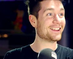 I like this because you rarely get a pic of Dan smiling with like this it makes my heart melt:')