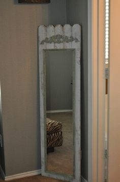 I MUST DO THIS TO THAT UGLY OLD MIRROR IN THE BEDROOM    R - A regular 'ol mirrow from Wal-Mart that was painted and then mounted to some old barn wood that was painted as well.  A wooded decal from a craft store add additional interest.