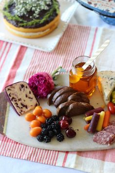 A little honey goes a long way with your brunch spread. Ingredients: Variety of cheese blocks ranging from mild to sharp in flavor, Cured meats such as salumi and prosciutto, Baguette or bread loaf, Fruits such as cherries and blackberries, Honey or fruit jam, Olives and spicy peppers