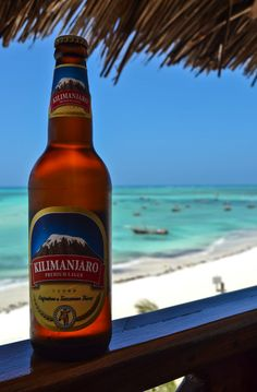 Kilimanjaro beer is a staple drink in Tanzania! You cannot not have one when on a safari, in Arusha, or in Mt. Stone Town, Arusha, Kilimanjaro, Fishing Villages, Snorkeling, Dream Vacations, Beer Bottle, Stuff To Do, The Good Place