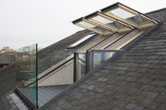"""This conversion is on top of the floor of an apartment block in London's Docklands. The Master bedroom leads out onto a """"Roof Terrace"""" via a velux window and door system. The terrace itself has a modern man made decking system that is non slip and non Loft Conversion Balcony, Loft Conversion Gallery, Dormer Loft Conversion, Loft Conversion Bedroom, Loft Conversions, Terraced House Loft Conversion, Loft Conversion Velux Windows, Bungalow Loft Conversion, Loft Dormer"""
