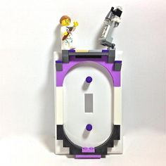 Clever Grrrl Artist 02 Switchplate made with LEGO® by BrickShtick, $33.25 USD