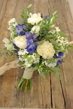 Wedding Ring Take Your Romance to a New High Bridal bouquet with blue delphiniums peonies stocks phloxsweetpeas lisianthus and eucalyptus Designed by ForgetMeNot Flowers. Blue Wedding Flowers, Bridal Flowers, Flower Bouquet Wedding, Floral Wedding, Bouquet Flowers, Elegant Wedding, Wedding Ring, Delphinium Bouquet, Blue Delphinium