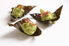 """Edamame Guacamole: Leave it to chef Wolfgang to serve """"chips and dip"""" a new way. Instead of guacamole and tortilla chips, he's serving edamame guacamole on a chip made with kombu, a Japanese seaweed.   Source: Andrea Bricco Photography"""