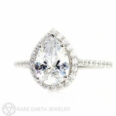 An absolutely astonishingly beautiful pear cut Moissanite and diamond ring in your choice of 14K White, Yellow or Rose gold. The center stone is a