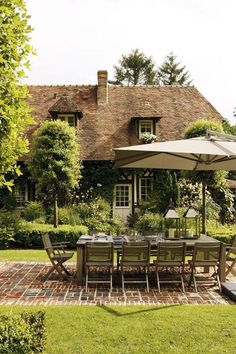 Pretty brickwork patio creating an attractive outdoor dining room.