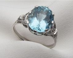 Mid-century oval 3.7 carat aquamarine ring in platinum. I love the circular shape- this would make a great engagement or anniversary ring!